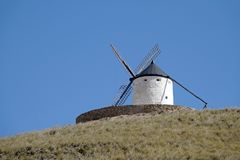 White Windmill on hill in Consuegra, Spain. Located about 60km from Toledo, Consuegra is a lovely historic town set against a range of low mountains. Twelve royalty free stock photo