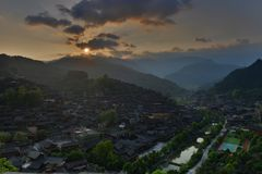 The sunrise in Xijiang Qianhu Miao Village. Located on the north side of Leigong Hill, Xijiang Qianhu Miao Village is about 35 km 22 miles away from Kaili city stock images