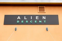Alien Descent attraction sign stock photography