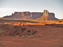 Sunset over Monument Valley Sandstone Formations. Located on the Utah and Arizona border, Monument Valley is one of the most recognized locations in the world Stock Image