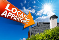 Location Appartement (in French) - Arrow Sign. Sign in arrow shape with inscription: rental apartment (in French) on blue sky with roof, clouds and sun rays Royalty Free Stock Photography