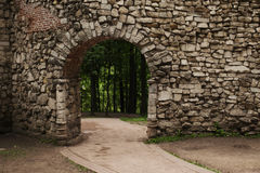 Location from the arch and stone wall, paths and forests in the background Stock Photos