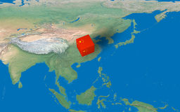 Location of China over the map. 3d design rendered of a cube with China flag over the map Royalty Free Stock Images