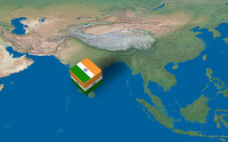 Location of India over the map. 3d design rendered of a cube with Indian flag over the map Stock Image
