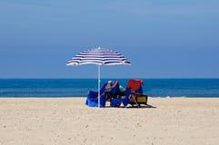 Beach, Sun umbrella, sun beds with towels royalty free stock photo