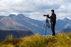 On Location Photographer. Professional nature and landscape photographer (man) at work outdoor on location Stock Photo