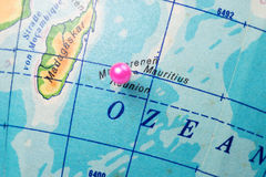 Location Reunion Island. Pink pin on the globe Stock Photo