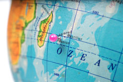 Location Reunion Island. Pink pin on the globe Royalty Free Stock Image