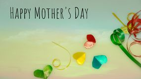 Happy Mother`s Day words with small colorful heart shaped and gift boxes as background. royalty free stock photography