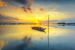 Parking boat in the village beach. Location sekupang sub-districts, batam city, indonesia country, moment sunset, high tide, background yellow sun royalty free stock photo