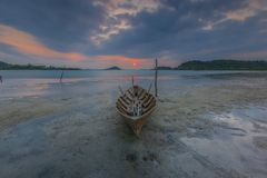 Traditional boat in the beach. Location setokok districts, batam city, indonesia country, moment sunset, low tide royalty free stock photo