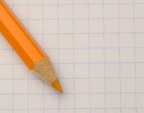 Location sharpened pencil on notebook sheet Stock Images