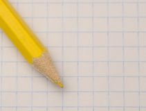 Location sharpened pencil on notebook sheet Royalty Free Stock Photo