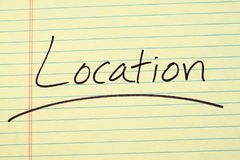 Location On A Yellow Legal Pad. The word `Location` underlined on a yellow legal pad Stock Photo
