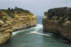Limestone and sandstone cliffs with ocean waves and sunshine at Loch Ard Gorge, Great Ocean Road, Southern Victoria, Australia. Stock Photo
