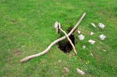 Loch auf einem Gebiet Stockbild