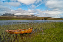Loch Awe. A small fishermans boat on the banks of Loch Awe Stock Photography