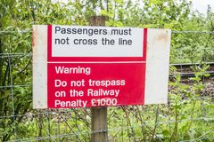 Loch Awe, Argyll , Scotland - May 15 2017 : Sign warning not to tresspass the railway. LOCH AWE, ARGYLL, Scotland - MAY 15 2017 : Sign warning not to tresspass Stock Photos