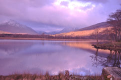 Loch Awe Scottish Highlands. Reflections of the mountains and trees in loch awe scotland Royalty Free Stock Photography