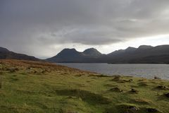 Loch Bad a Gail with dramatic sky. Scenery around Loch Bad a Gail in Scotland Stock Photo
