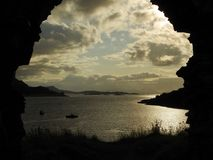 Loch Carron through ruined arch of Strome Castle royalty free stock photo