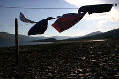 Loch Carron Washing Line. Someone elses normal isnt always the same as yours royalty free stock photo