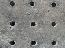 Loch in der Abfluss-Kappen-Hintergrund-Beschaffenheit stockfoto