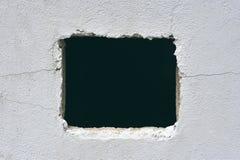 Loch in der Betonmauer Lizenzfreie Stockfotos