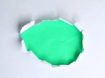 Loch in der Papierzusammenfassung Stockfotografie