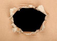 Loch in der Pappe Lizenzfreies Stockfoto