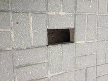Loch in der Pflasterung Stockbilder