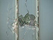 Loch in einem Fenster Lizenzfreies Stockbild