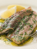 Loch Fyne Kippers Grilled with Parsley Butter Royalty Free Stock Image