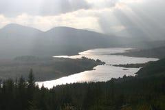 Loch Garry. Sunbeams illuminate the bridge over Loch Garry Royalty Free Stock Images