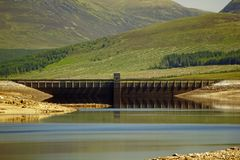 Loch Glascarnoch Dam. Loch Glascarnoch, a reservoir 7km long, is about halfway between Ullapool and Inverness Royalty Free Stock Images