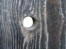 Loch im Holz lizenzfreie stockbilder