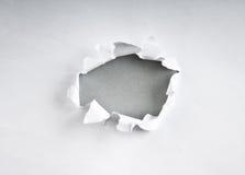 Loch im Papier Lizenzfreie Stockfotografie
