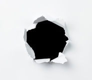 Loch im Papier Stockbild