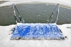 Loch im Wintermeer Stockbild