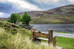 Bench at Loch Lee, Angus, Scotland, UK. Cairngorms National Park. Loch Lee is a loch in Angus, Scotland south of the Grampian Mountains that is fed by the Water stock photography