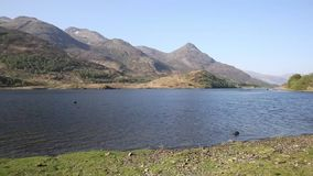 Loch Leven Scottish lake west coast of Scotland in Scottish Highlands west of Kinlochleven and just off B863 pan stock footage