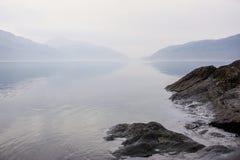 Loch Lomond lake in the fog stock photo
