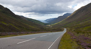 Loch Maree from Glen Docherty. The road leading down the Glen toward the Loch with mountains on either side Royalty Free Stock Photography