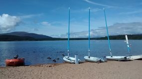 Loch Morlich. Loch boats water sun highlands scotland Stock Image
