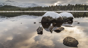 Loch Morlich and the Cairngorms in Scotland. Stock Photo
