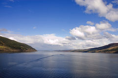 Loch Ness. With tourist boat cruising the loch creating a wake Stock Photography