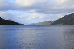 Loch Ness in highlands of Scotland with fort Augustus with mountains. In summer with tourists Royalty Free Stock Photography