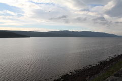 Loch Ness / Lochness. Loch Ness is a very large and deep freshwater loch which is located in the Highlands of Scotland. It is famous of the Myth about the Loch Stock Photo