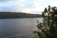 Loch Ness / Lochness. Loch Ness is a very large and deep freshwater loch which is located in the Highlands of Scotland. It is famous of the Myth about the Loch Royalty Free Stock Photos