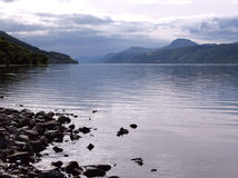 Loch Ness. Looking along Loch Ness on a February afternoon towards the distinctively shaped hill, Meall Fuarvonie Royalty Free Stock Photo